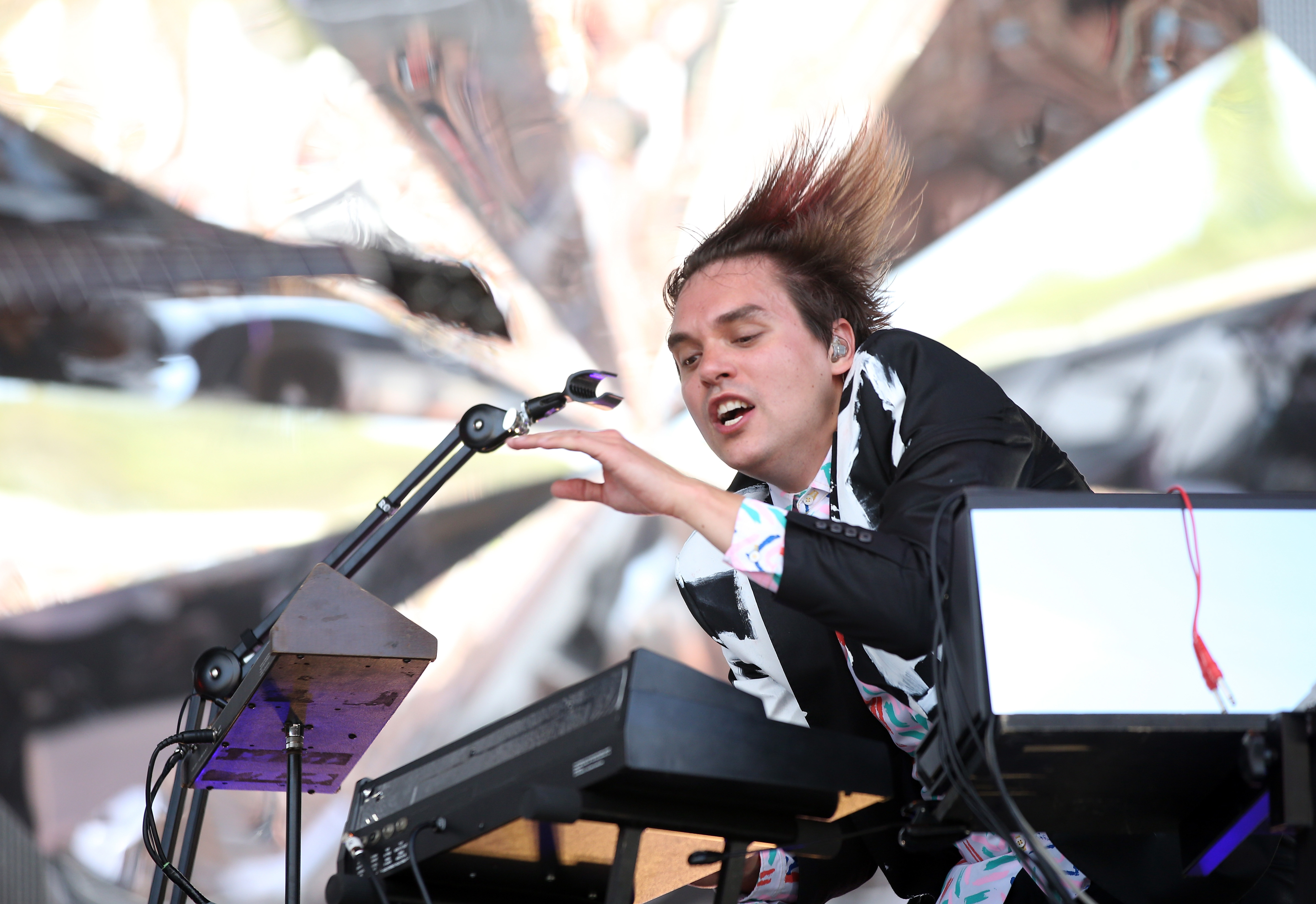 AUCKLAND, NEW ZEALAND - JANUARY 17:  William Butler of Arcade Fire performs live for fans during the 2014 Big Day Out Festiva