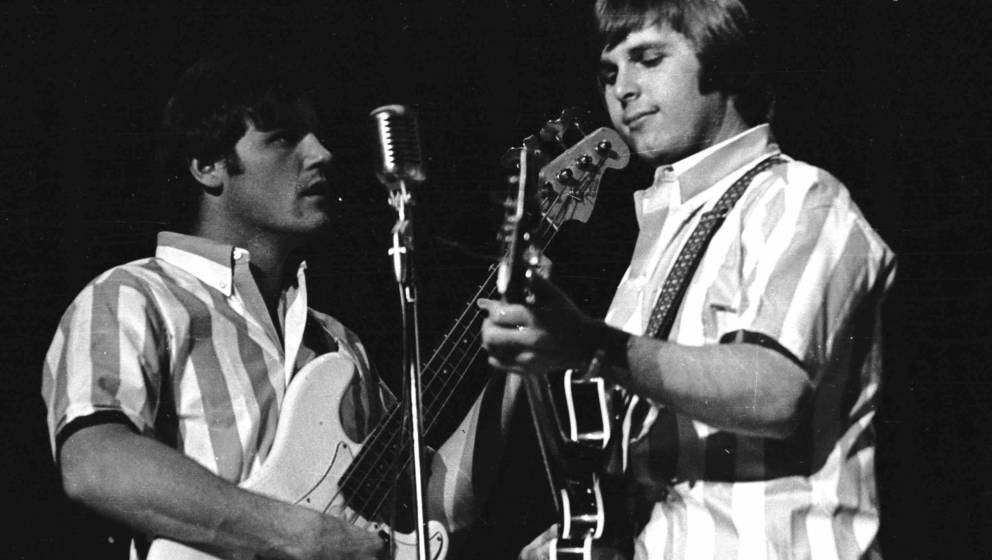 CIRCA 1966: Bruce Johnston (right) and Carl Wilson of the rock and roll band 'The Beach Boys' perform onstage in striped shir