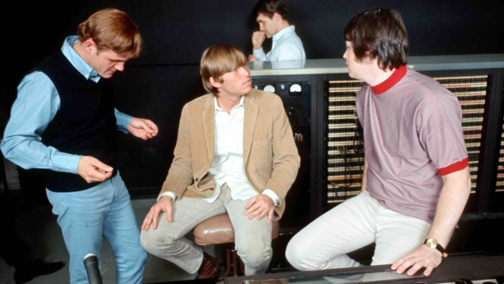LOS ANGELES - 1966: Singer Brian Wilson (wearing red shirt) of the rock and roll band 'The Beach Boys' talks to engineers and