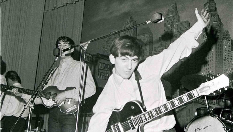 GERMANY - MAY 01: Photo of (L-R) singer-bassist Paul McCartney and guitarist George Harrison of The Beatles, live onstage cir