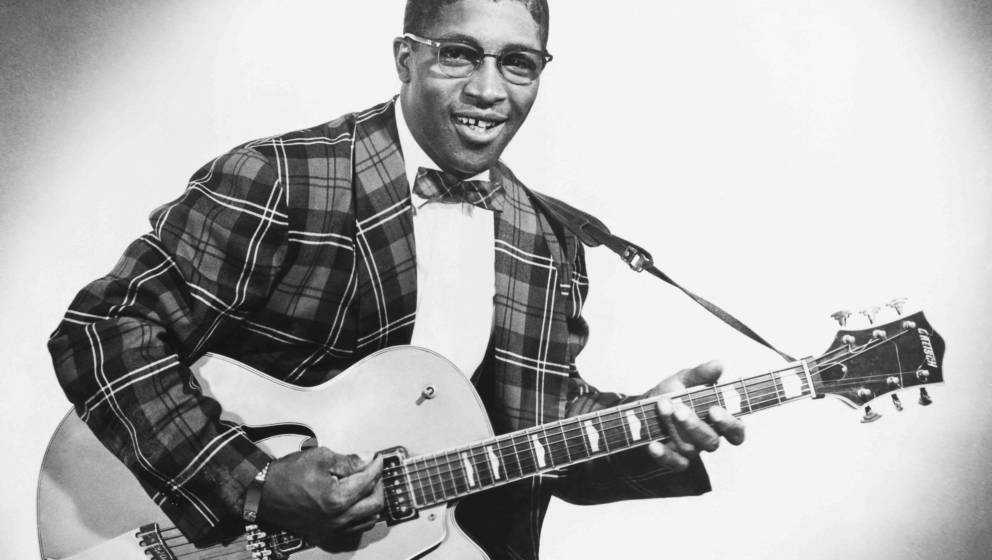 CIRCA 1957: Bo Diddley poses for a portrait with his trademark square Gretsch electric guitar in circa 1957 in New York City,