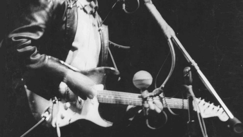 NEWPORT, RI - JULY 25: Bob Dylan plays a Fender Stratocaster electric guitar for the first time on stage as he performs at th