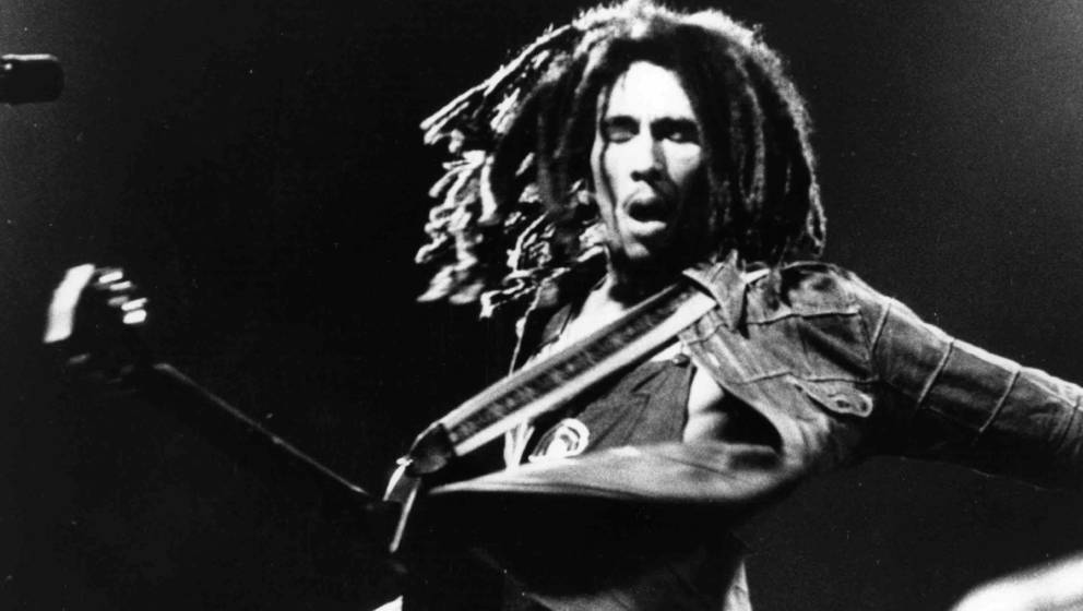 Bob Marley (1945 - 1981) the Jamaican born singer, guitarist and composer in concert.   (Photo by Keystone/Getty Images)