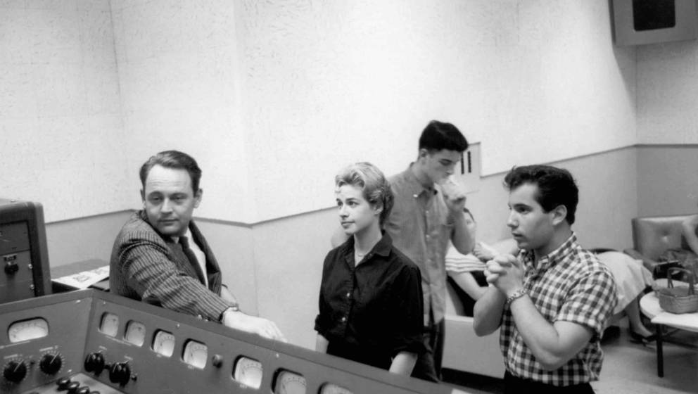 NEW YORK, NY - CIRCA 1959: Singer songwriters Carole King, Paul Simon (right)and Gerry Goffin (back) between takes in a New Y
