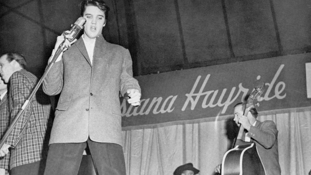 1954:  Rock and roll singer Elvis Presley with his bass player Bill Black on tour with the Louisiana Hayride show in 1954. (P