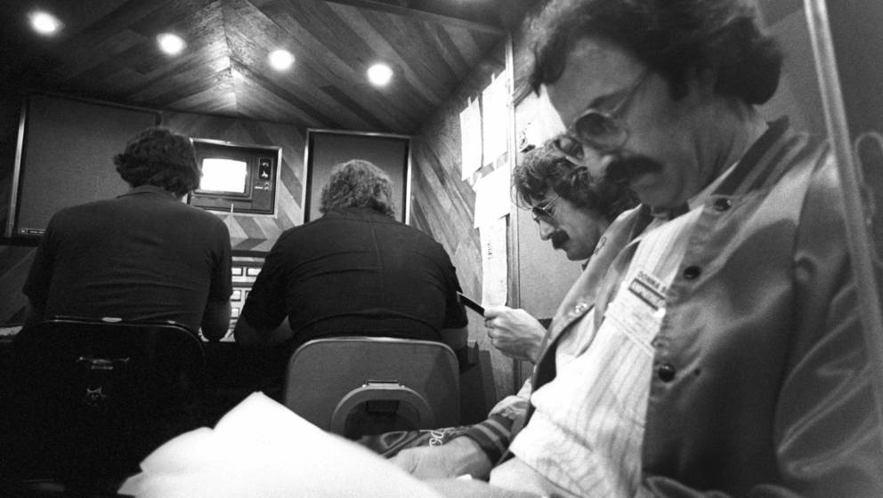 LOS ANGELES - CIRCA 1977:  Songwriters and producers L-R Pete bellotte and Giorgio Moroder backstage at the taping of a Donna