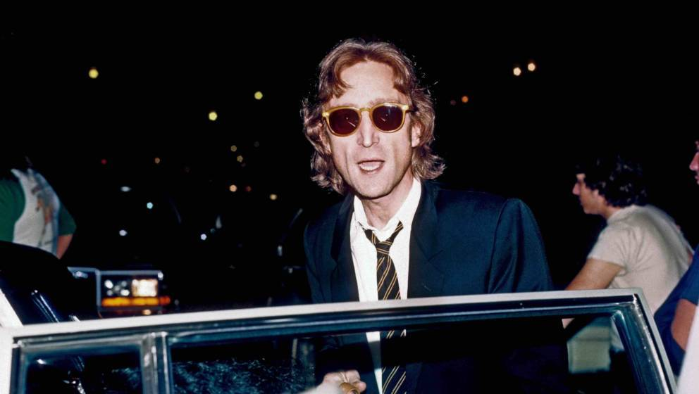 NEW YORK - AUGUST 1980: Former Beatle John Lennon arrives at the Times Square recording studio 'The Hit Factory' before a rec
