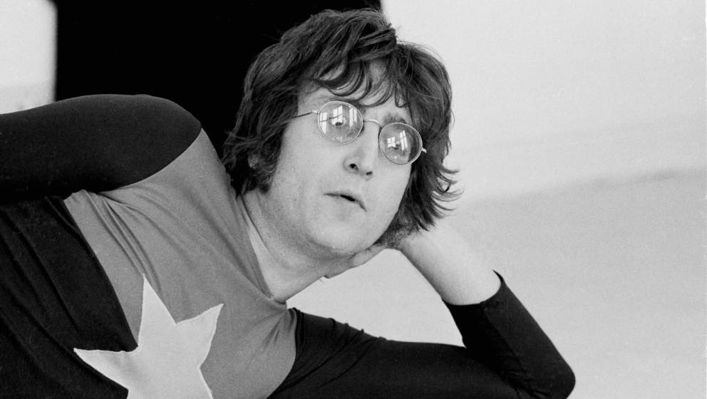 Former Beatle John Lennon (1940 - 1980) at his home, Tittenhurst Park, near Ascot, Berkshire, July 1971. (Photo by Michael Pu