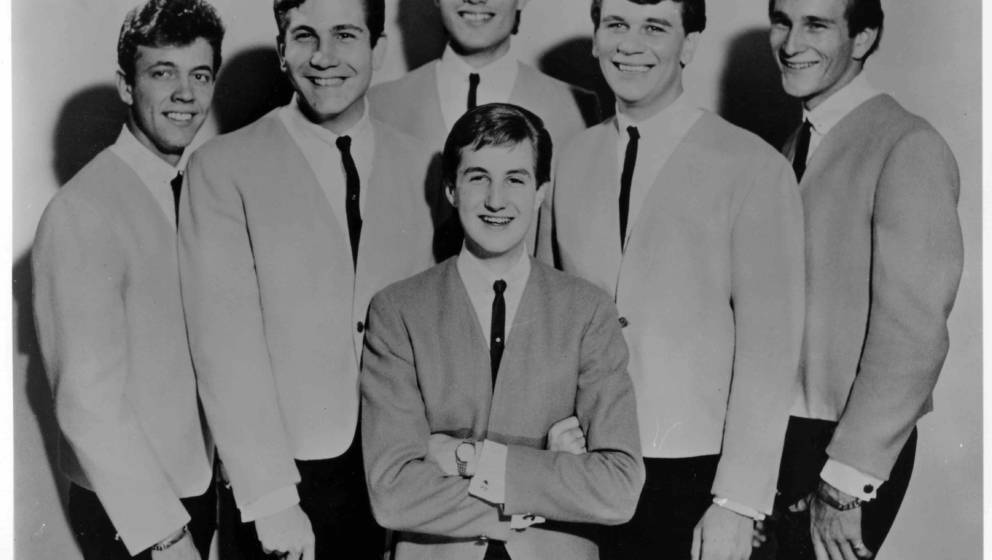 1964:  Jack Ely (center) poses for a portrait with his group 'Jack Ely And The Kingsmen' in 1964. This is a group that he for