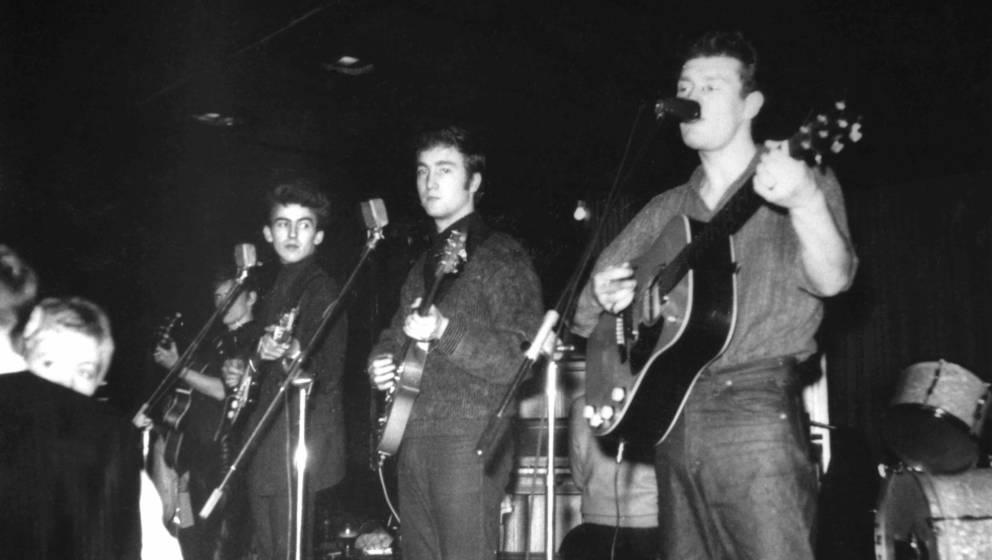 GERMANY - CIRCA 1960:  Photo of Tony SHERIDAN and BEATLES; L-R: George Harrison, John Lennon and Tony Sheridan performing liv