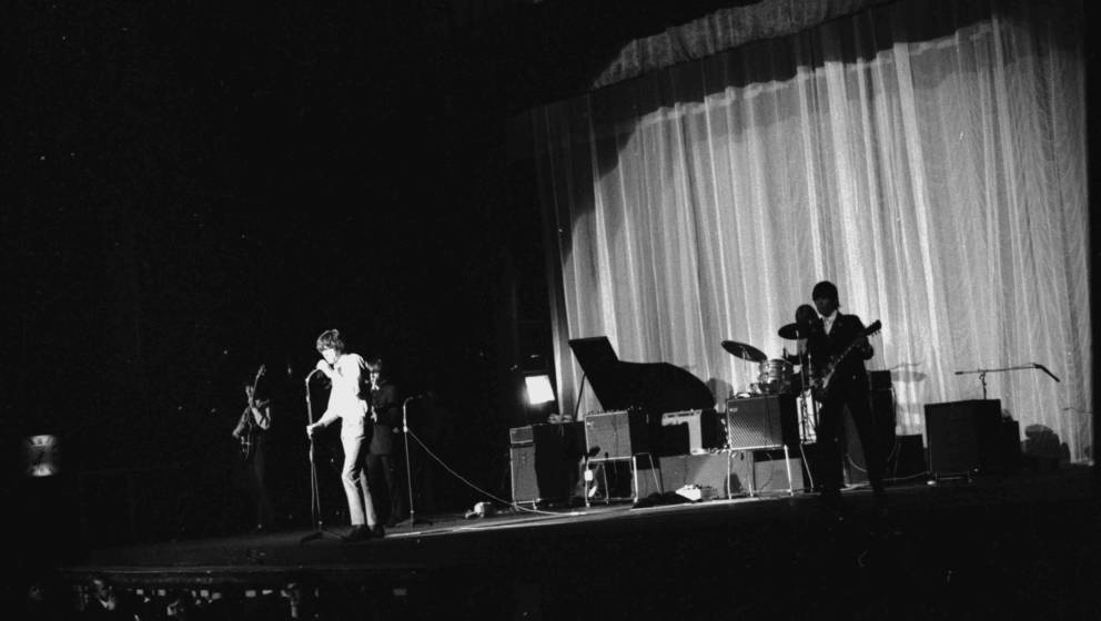 January 1965:  A Rolling Stones concert with singer, Mick Jagger in the spotlight.  (Photo by Keystone Features/Getty Images)