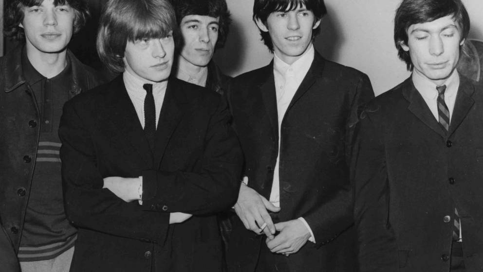circa 1965:  The Rolling Stones at London Airport, prior to leaving for New York on a three week tour of America, They are, f