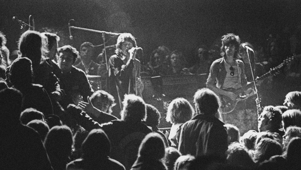 LIVERMORE, CA - DECEMBER 6: Mick Jagger and Keith Richards of the Rolling Stones warily eye the Hells Angels onstage at The A
