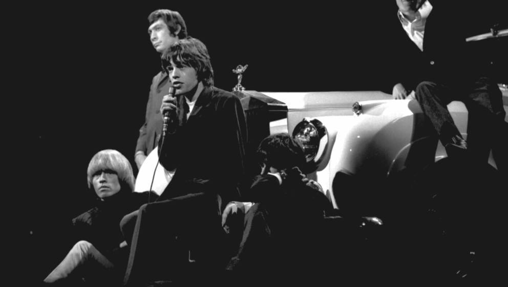 1965: Rock and roll band 'The Rolling Stones' performs onstage on a TV show leaning against a Rolls Royce in 1965. (L-R) Bria