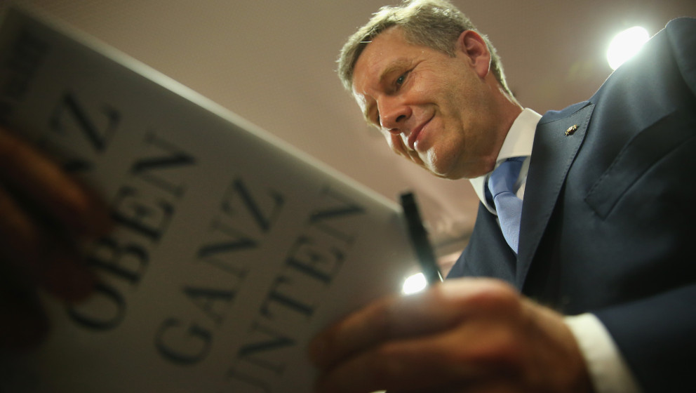 BERLIN, GERMANY - JUNE 10:  Former German President Christian Wulff signs his new book 'Ganz oben. Ganz unten.', which in Eng