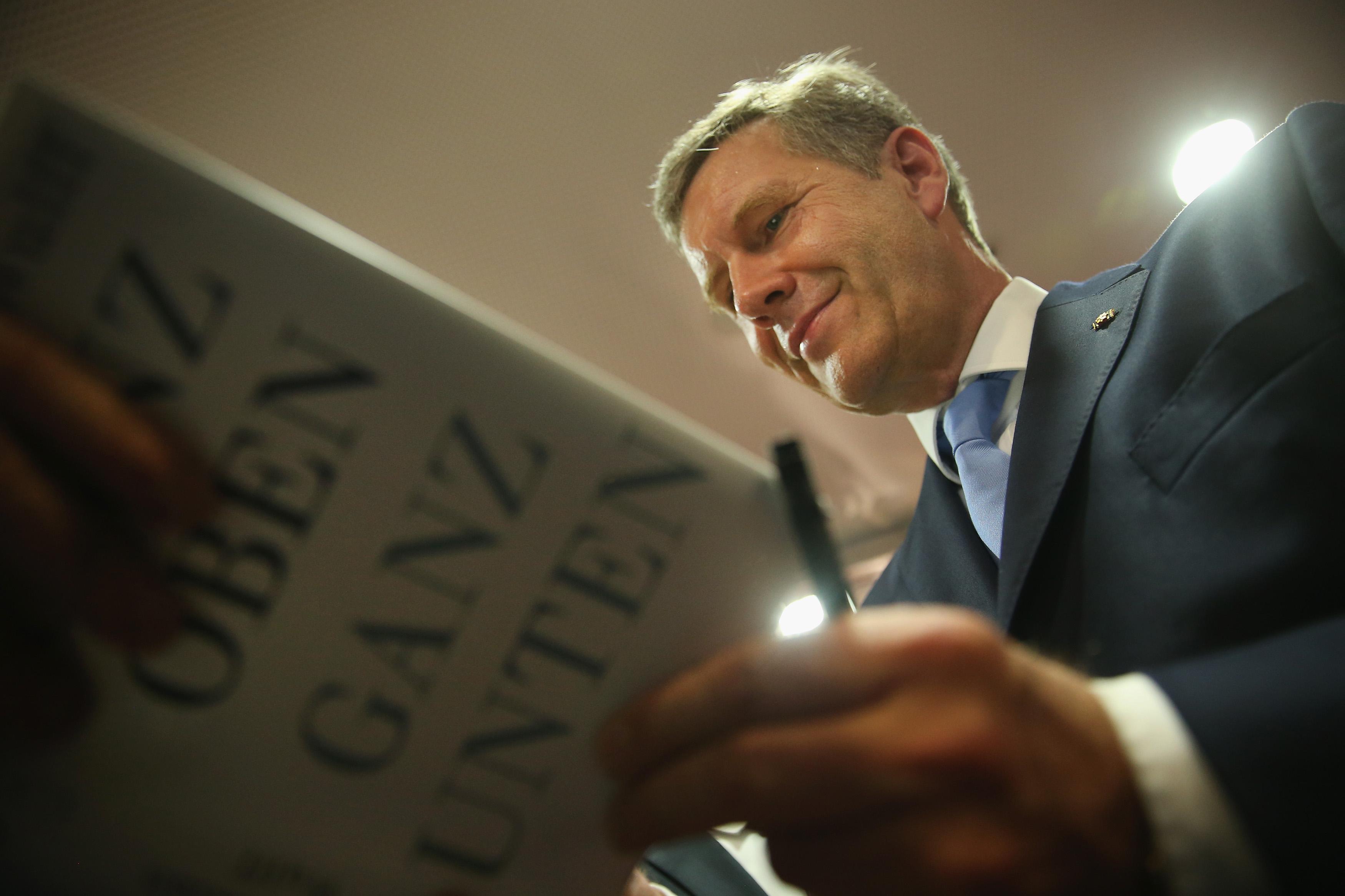 BERLIN, GERMANY - JUNE 10:  Former German President Christian Wulff signs his new book 'Ganz oben. Ganz unten.', which in Eng