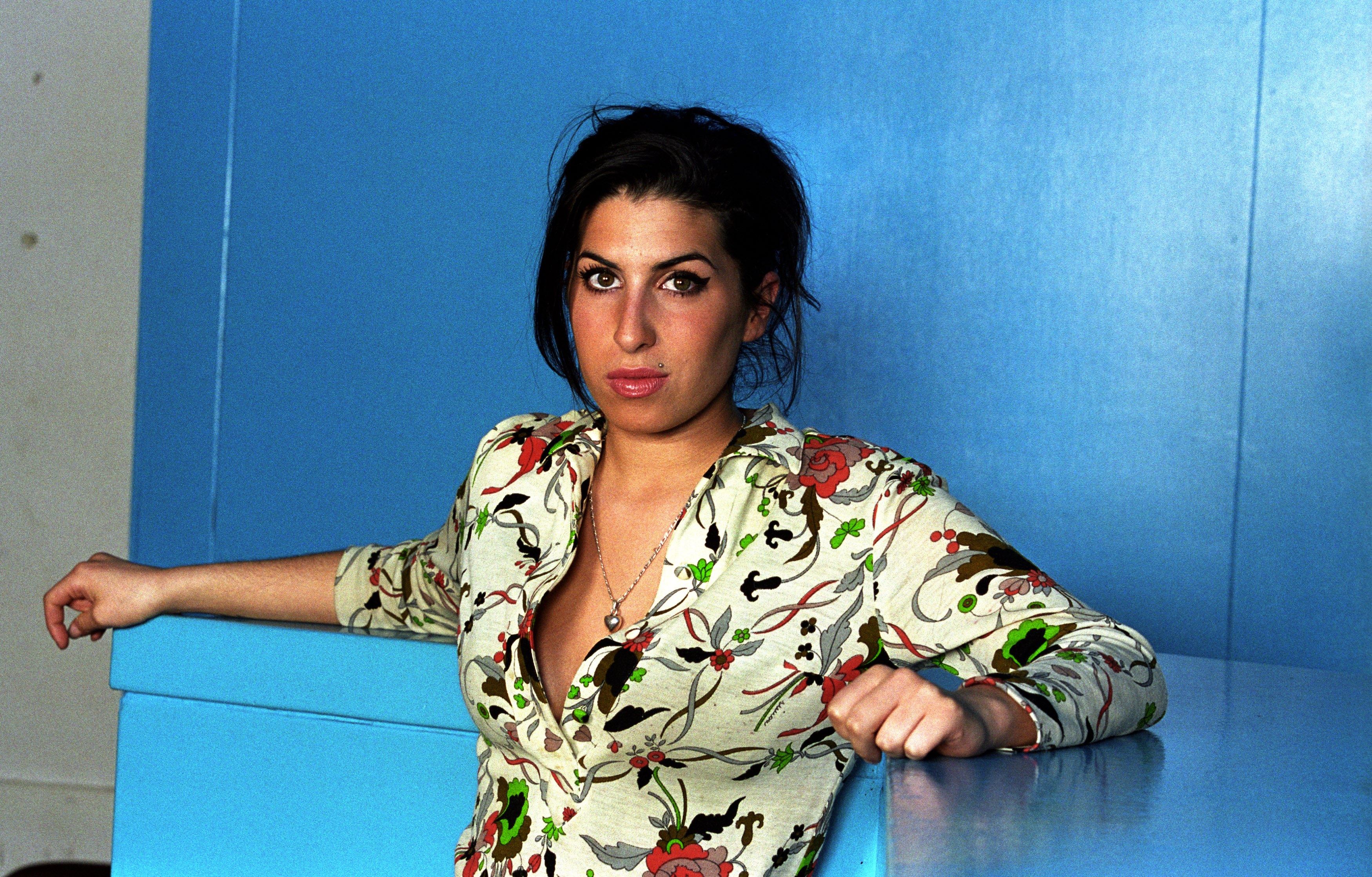 ROTTERDAM, NETHERLANDS - MARCH 11: Amy Winehouse poses for a studio portrait in Rotterdam, Netherlands, 11th March 2004. (Pho