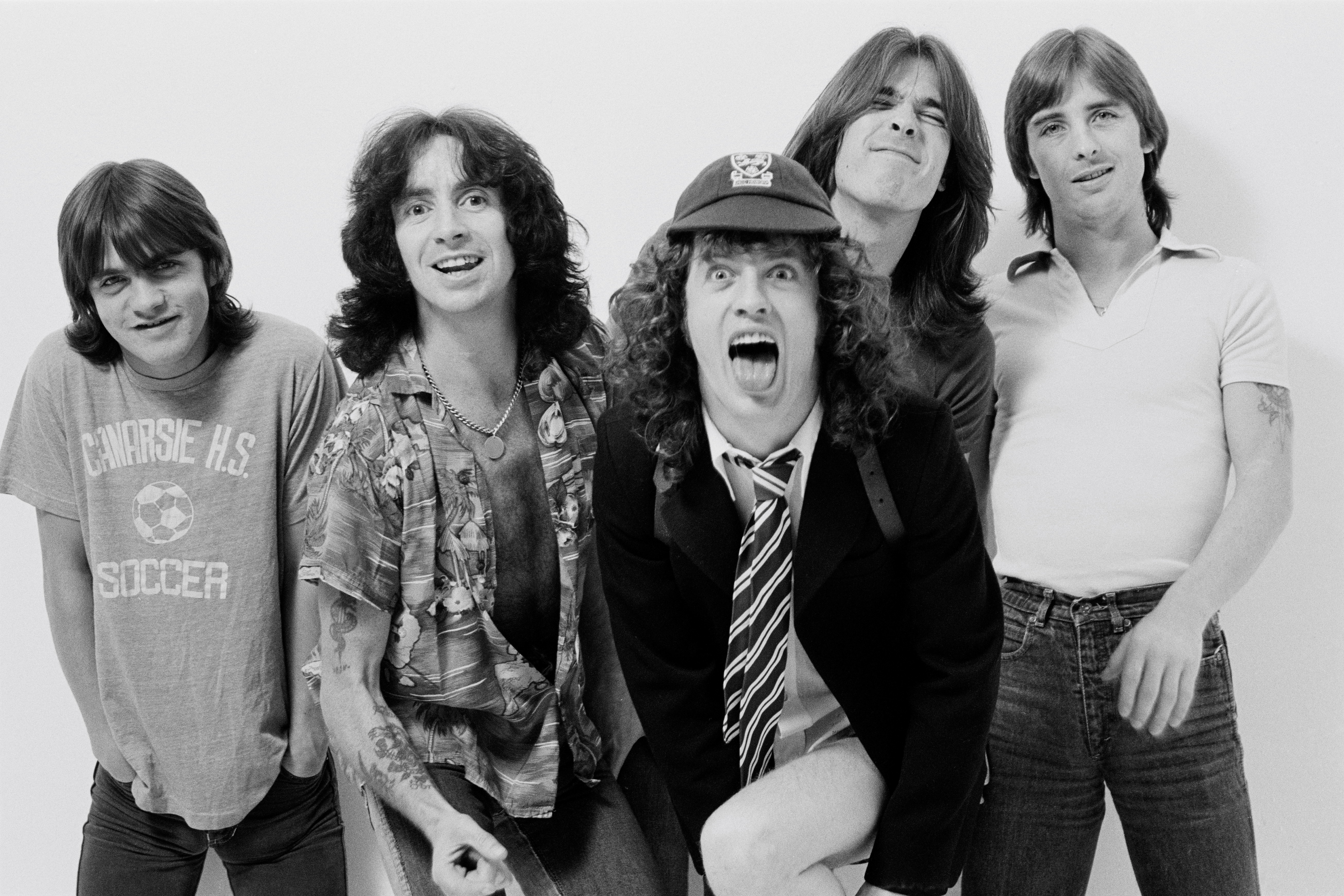 LONDON -  1st AUGUST: Australian rock band AC/DC posed in a studio in London in August 1979. Left to right: Malcolm Young, Bo