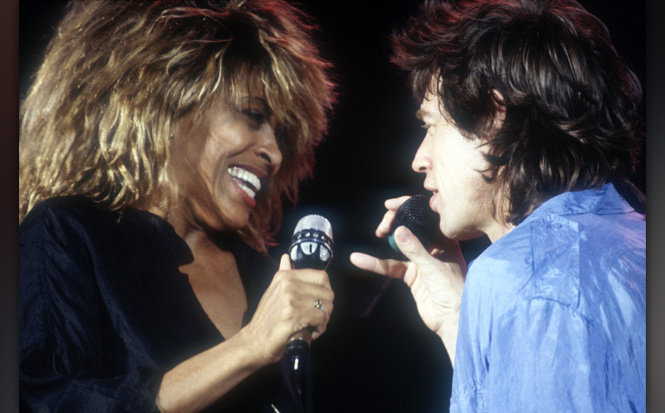PHILADELPHIA, PA - JULY 12: (L-R) Tina Turner and Mick Jagger rehearse their duet for the upcoming Live Aid concert at JFK St