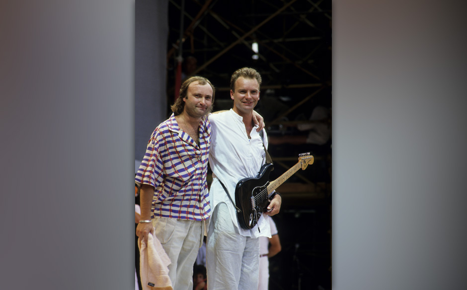 LONDON, UNITED KINGDOM - JULY 13:  Singers Sting (R) and Phil Collins perform at the Live Aid concert at Wembley Stadium in L