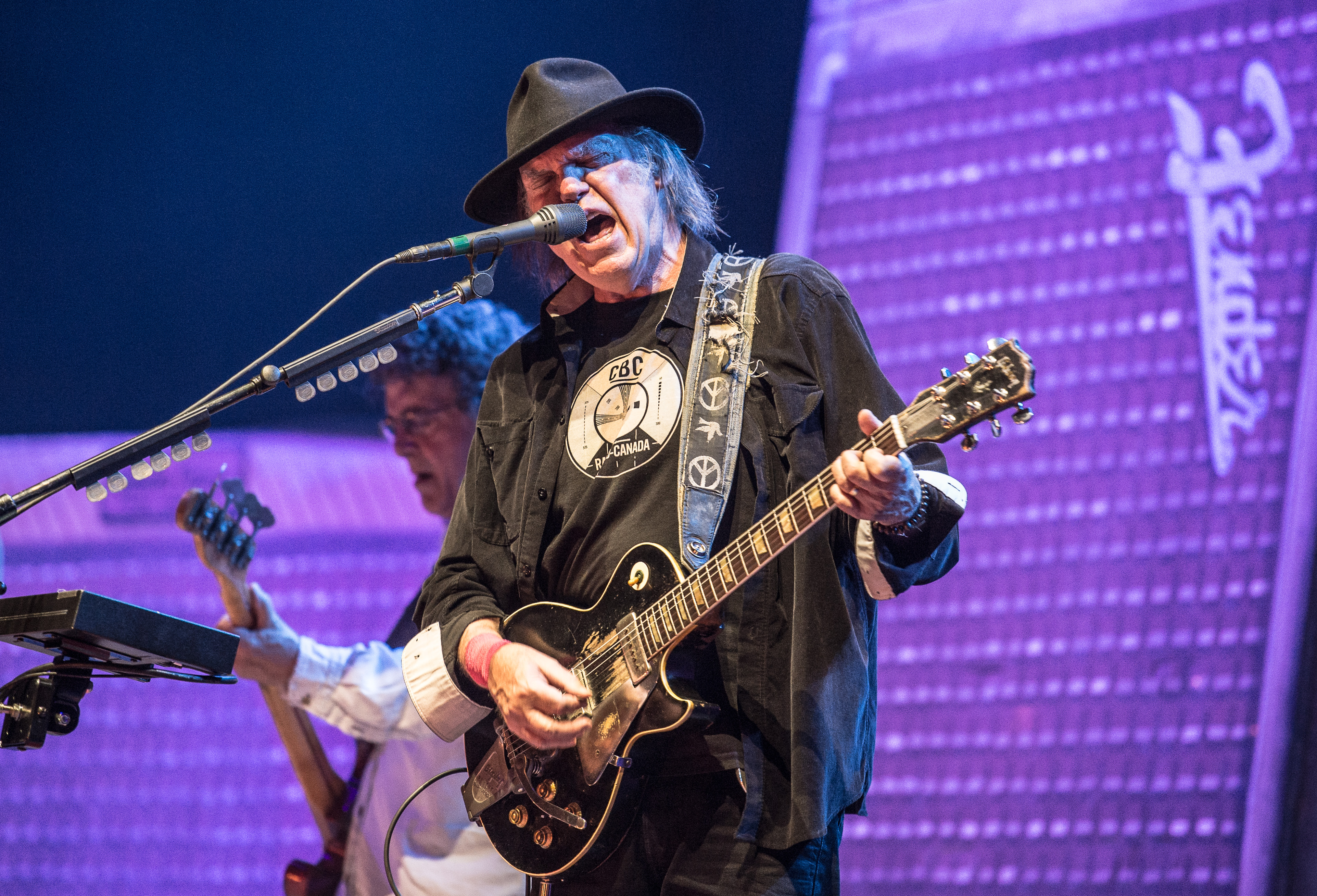 PARIS, FRANCE - JUNE 06: Neil Young performs at Palais Omnisports de Bercy on June 6, 2013 in Paris, France. (Photo by David