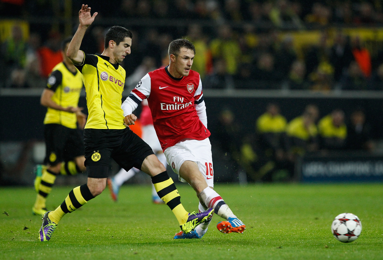 DORTMUND, GERMANY - NOVEMBER 06:  Aaron Ramsey (R) of Arsenal is challenged by Henrikh Mkhitarysan of Borussia Dortmund durin