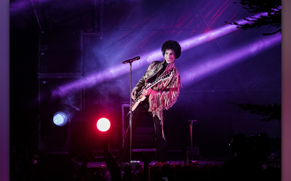 American music icon Prince is having a good time on stage and smiles to the listeners at Skanderborg Festival in Denmark. Den