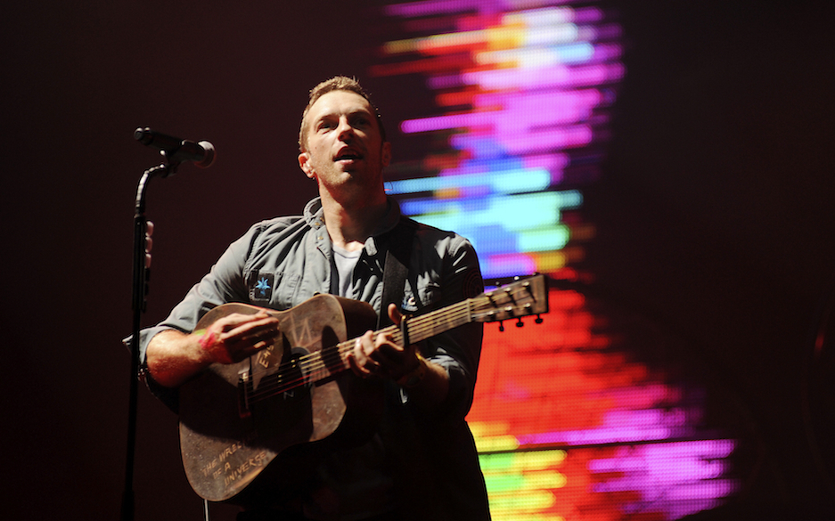 GLASTONBURY, UNITED KINGDOM - JUNE 25: Chris Martin of Coldplay headlines the Pyramid stage on the third day of Glastonbury F