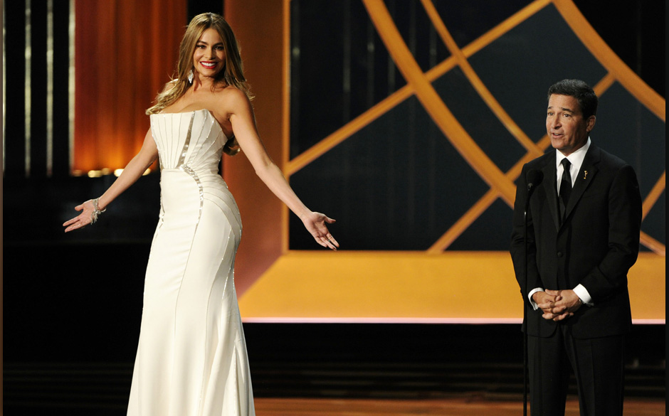 Sofia Vergara, left, and Television Academy CEO Bruce Rosenblum speak on stage at the 66th Annual Primetime Emmy Awards at th