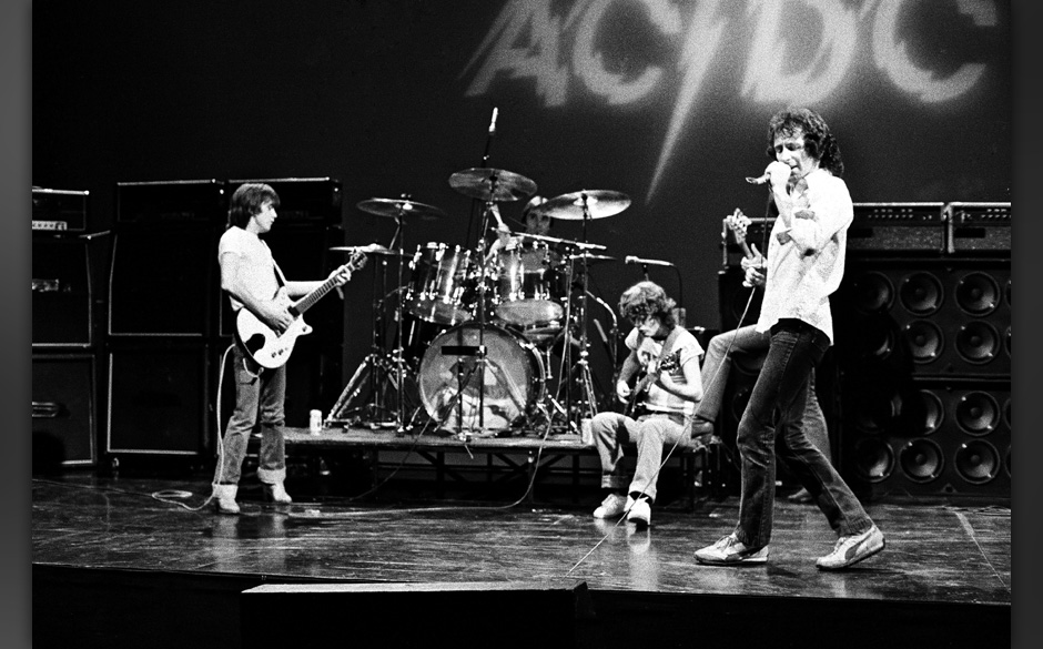 HOLLYWOOD - CIRCA 1977:  Rhythm guitarist Malcolm Young, drummer Phil Rudd, lead guitarist Angus Young, and singer Bon Scott