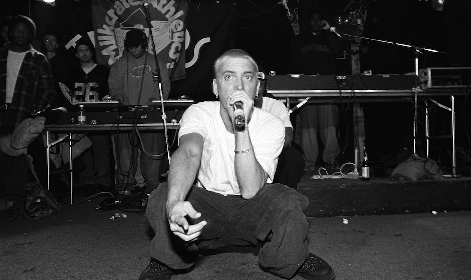 NEW YORK - MARCH 1999:  Rapper Eminem, with unidentified rappers and DJs in the background, performs at Tramps in March 1999