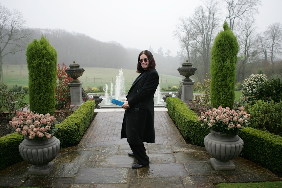 BUCKINGHAMSHIRE, ENGLAND - MARCH 30: Ozzy Osbourne plays the fool with the symbolic blue brick as he films the video for the