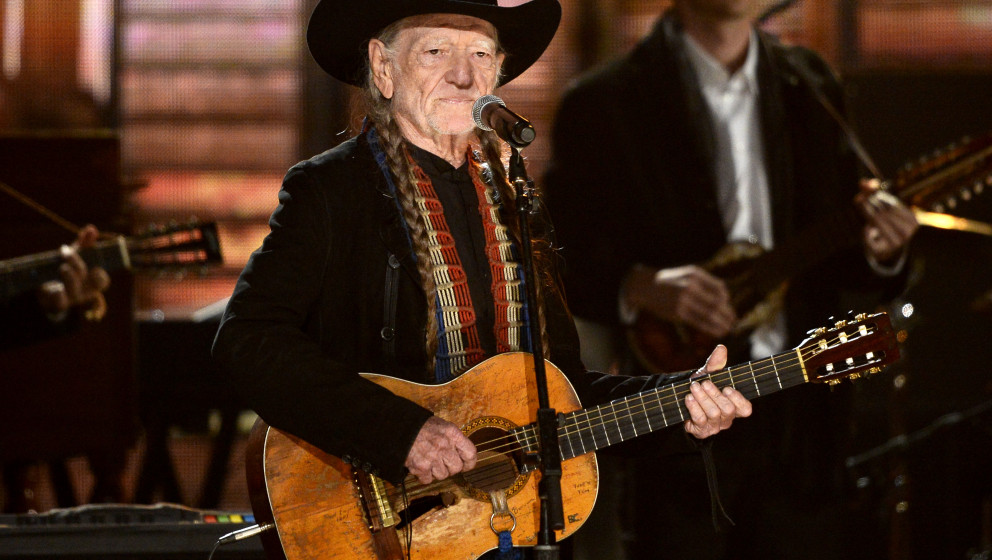 LOS ANGELES, CA - JANUARY 26:  Musician Willie Nelson performs 'Highwaymen' onstage during the 56th GRAMMY Awards at Staples