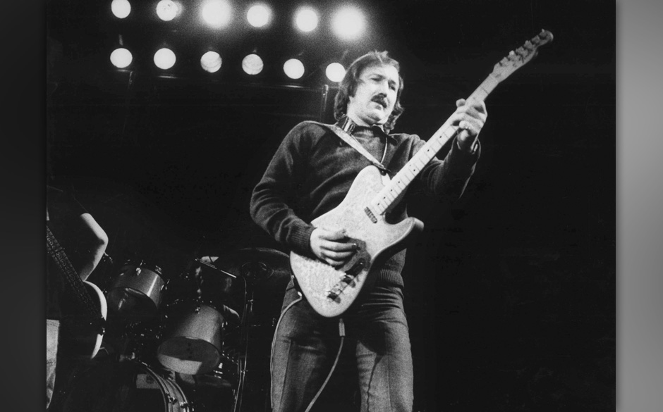 AMSTERDAM, NETHERLANDS - 1st JANUARY: American guitarist James Burton performs live on stage with the Emmylou Harris Hot Band