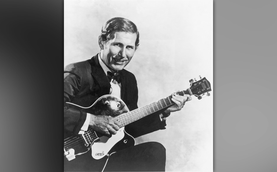 American producer and musician Chet Atkins (1924 - 2001) holding a Gretsch guitar, circa 1955. (Photo by Archive Photos/Getty
