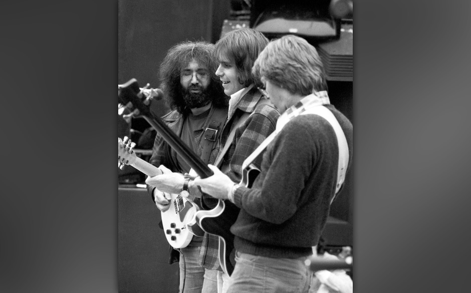 SAN FRANCISCO - SEPTEMBER 1975:  The Grateful Dead  (L to R: Jerry Garcia, Bob Weir, Phil Lesh) performs at a free concert in