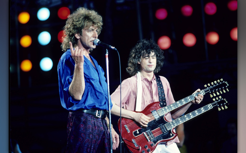 UNITED STATES - JULY 13:  Photo of Jimmy PAGE and LED ZEPPELIN and Robert PLANT and LIVE AID; L-R: Robert Plant, Jimmy Page p