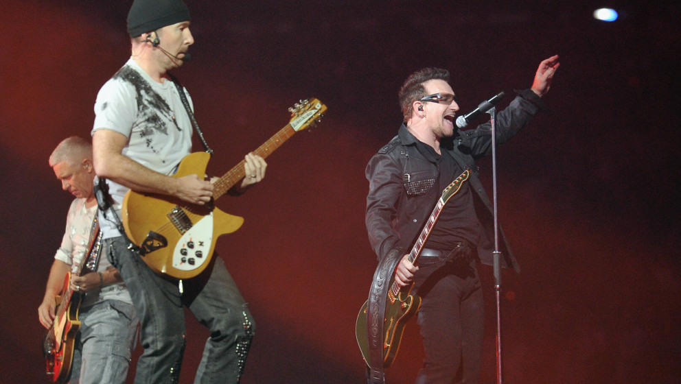 EAST RUTHERFORD, NJ - JULY 20: (L-R) U2 bass player Adam Clayton, guitar player The Edge and lead singer Bono perform at the