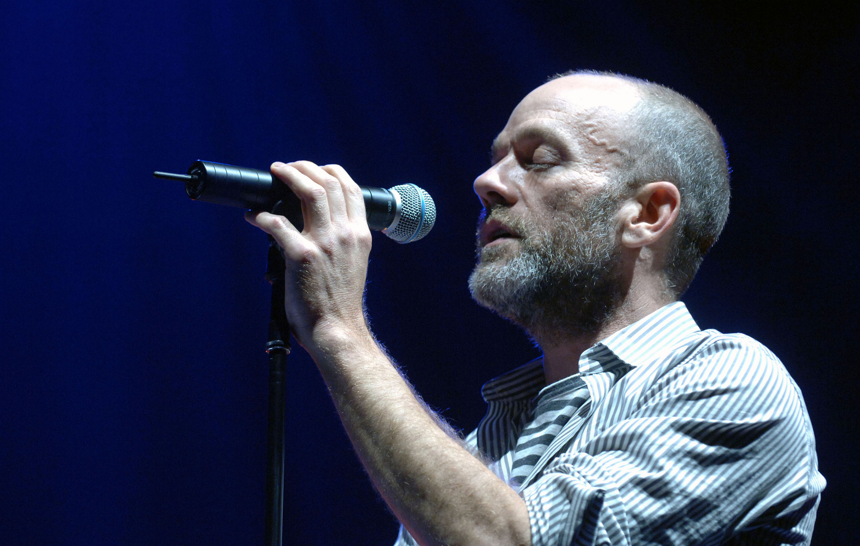 Michael Stipe of R.E.M. joins Chris Martin of Coldplay to perform 'NIGHTSWIMMING' (Photo by Rick Diamond/WireImage)