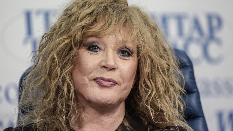 1479811 Russia, Moscow. 05/30/2013 Singer Alla Pugacheva signing cards after the press-conference 'The Civic Platform Party's