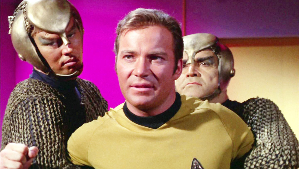 LOS ANGELES - SEPTEMBER 27: William Shatner as Captain James T. Kirk restrained by two Romulan security escorts in the STAR T