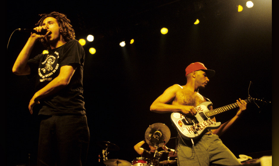 SAN JOSE, CA - SEPTEMBER 3: Zack de la Rocha (L) and Tom Morello of Rage Against the Machine perform in support of the bands'