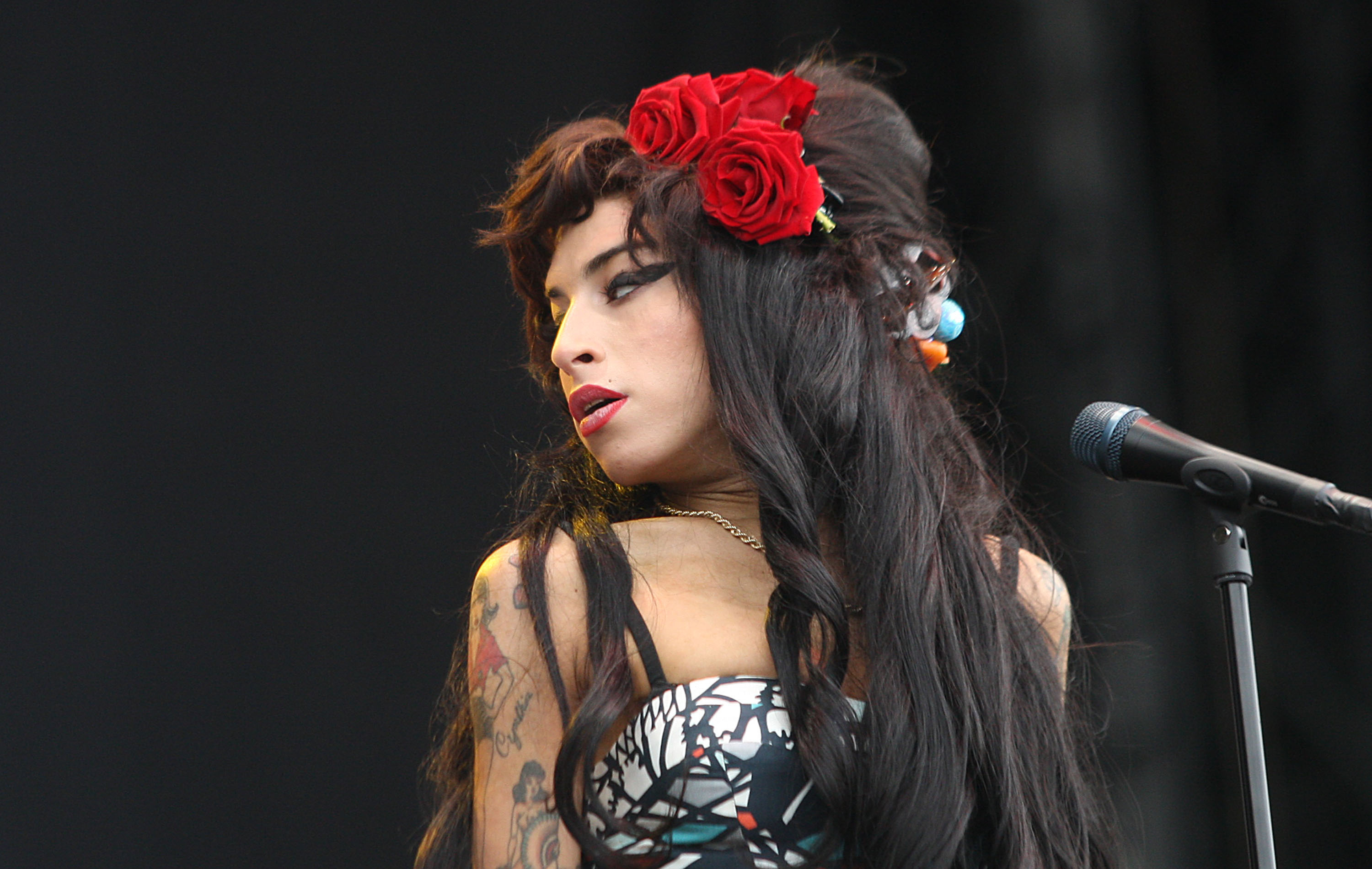 CHELMSFORD, UNITED KINGDOM - AUGUST 17:  Amy Winehouse performs on day two of the V Festival at Hylands Park on August 17, 20