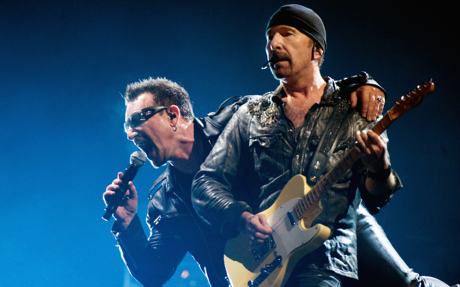 GLASTONBURY, ENGLAND - JUNE 24:  Bono (L) and The Edge of U2 headline the Pyramid Stage at the Glastonbury Festival at Worthy