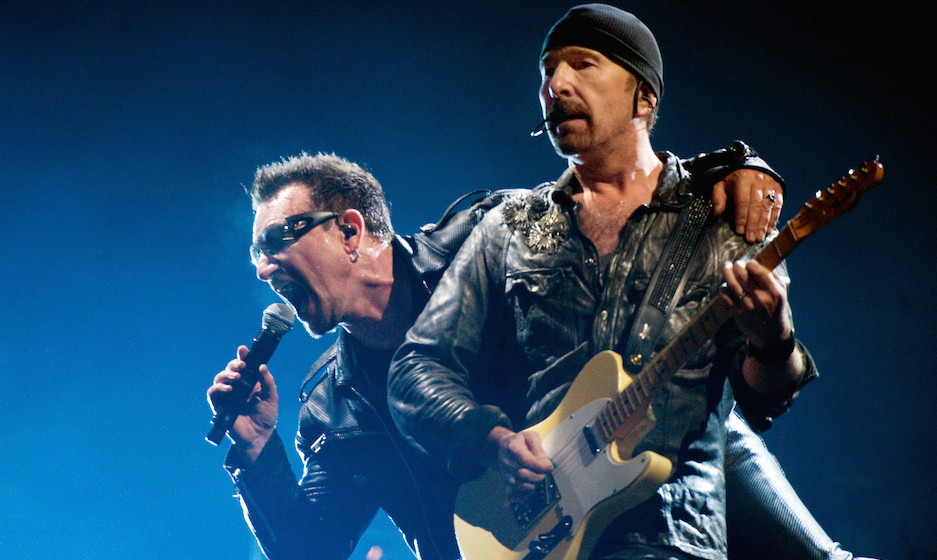 GLASTONBURY, ENGLAND - JUNE 24:  Bono (L) and The Edge of U2 headline the Pyramid Stage at the Glastonbury Festival at Worthy