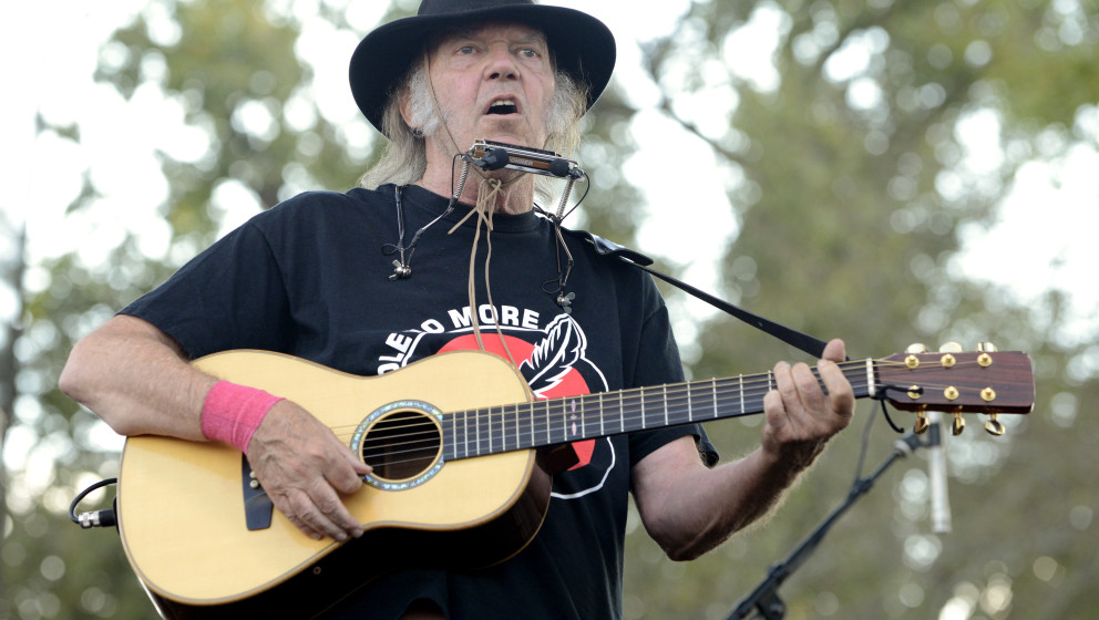 NELIGH, NE - SEPTEMBER 27:  Neil Young performs during the Harvest the Hope Benefit at Tanderup Farm  on September 27, 2014 i