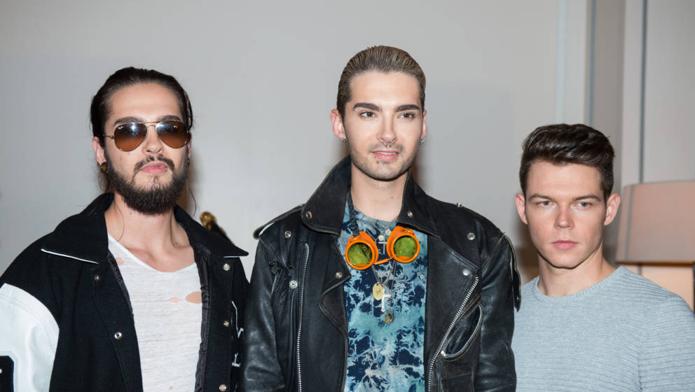 PARIS, FRANCE - OCTOBER 08: Bill Kaulitz, Tom Kaulitz and Georg Listing from Tokio Hotel are posing at Hotel de Sers during P