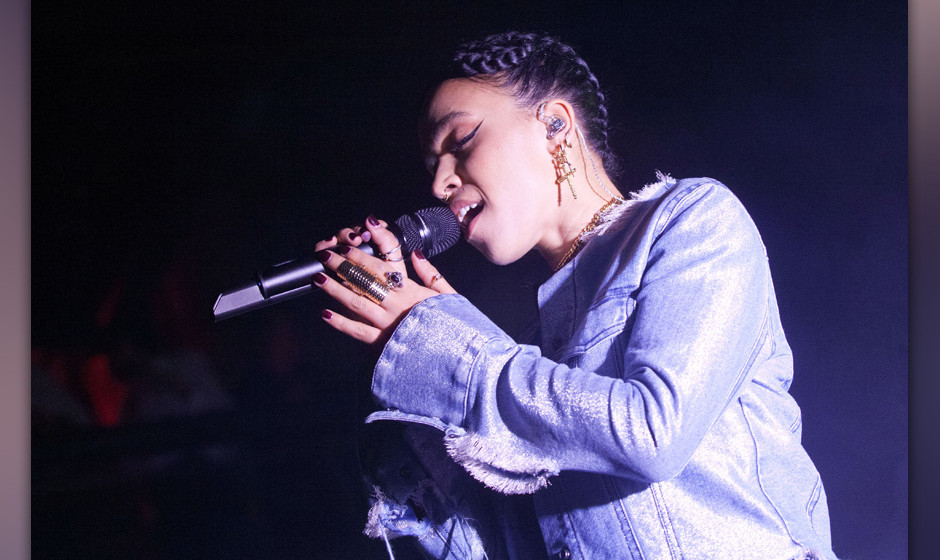 BERLIN, GERMANY - OCTOBER 21: British singer Tahliah Barnett aka FKA Twigs performs live during a concert at the Kesselhaus o