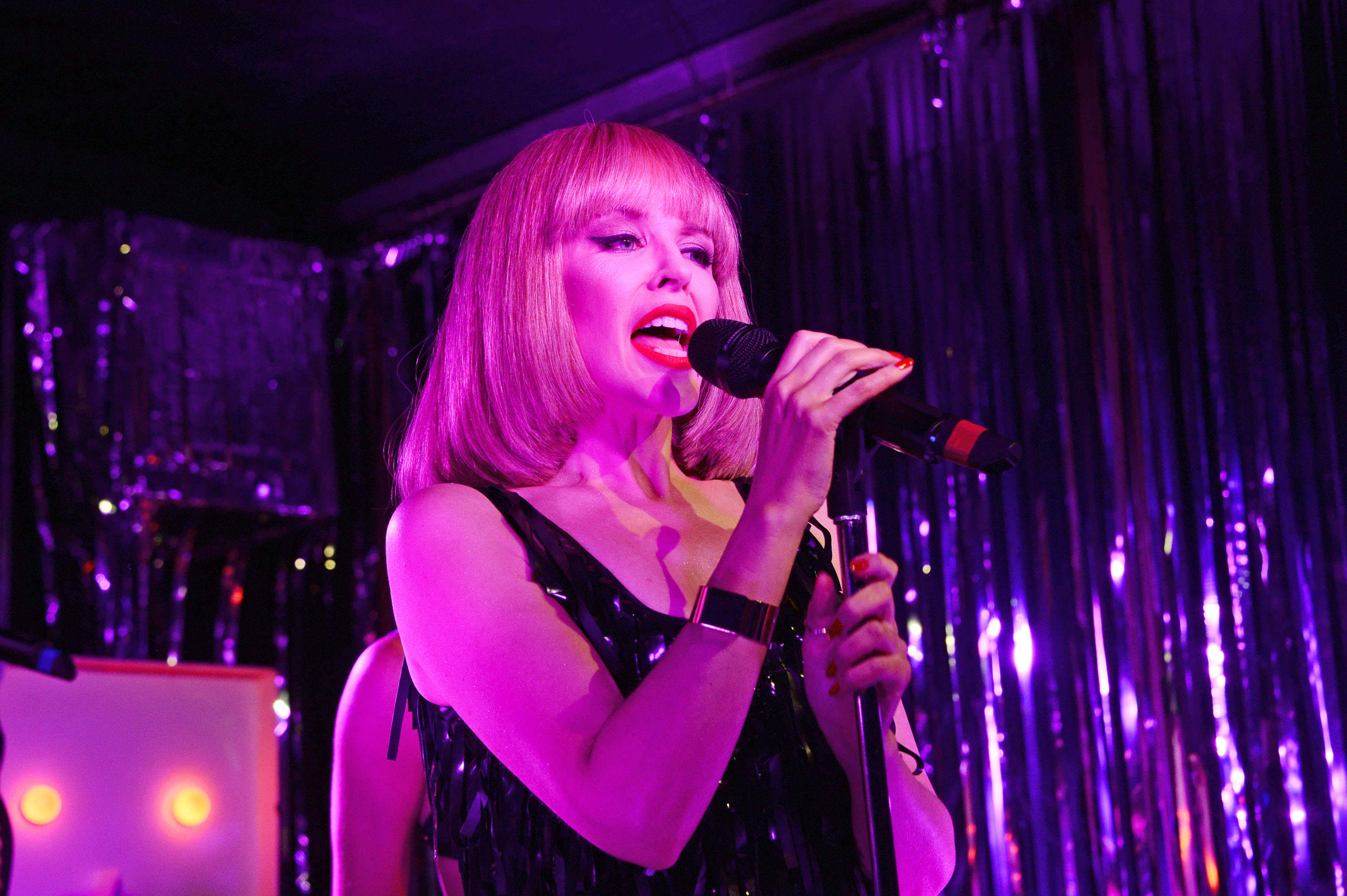 LONDON, ENGLAND - FEBRUARY 13:  Kylie Minogue plays a surprise gig at London pub  The Old Blue Last in Shoreditch on February