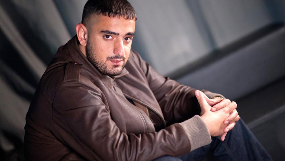 Der Deutsch-Rapper 'Haftbefehl', bürglich Aykut Anhan, aufgenommen am 12.05.2014 in Berlin. Foto: Christoph Schmidt/dpa